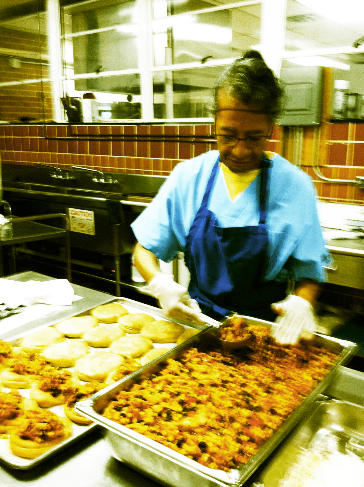Cafeteria worker preparing meals as part of Chef Challenge.
