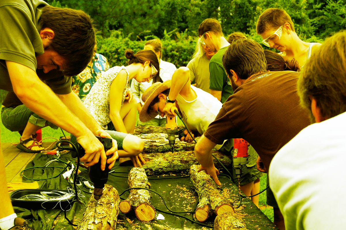 Workshop participants learning to grow their own mushrooms.
