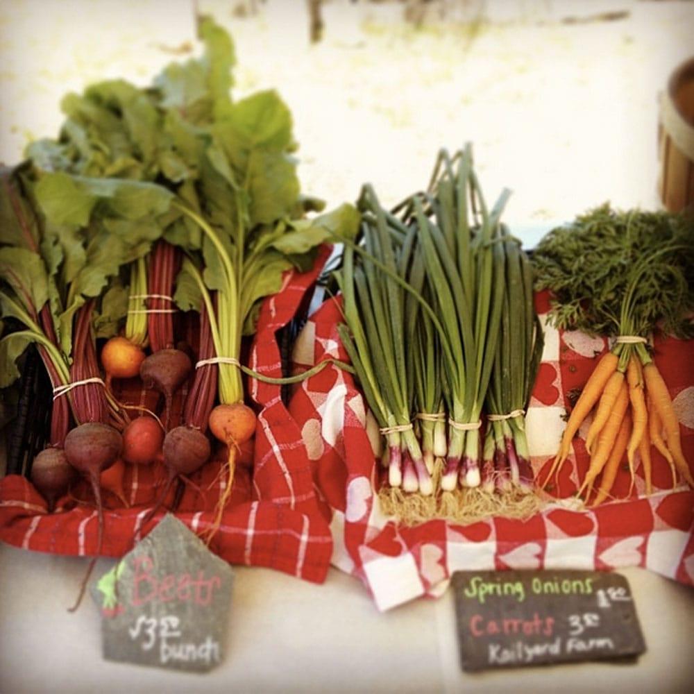 Harvesting the bounty of an urban farm. Via Raleigh City Farm.