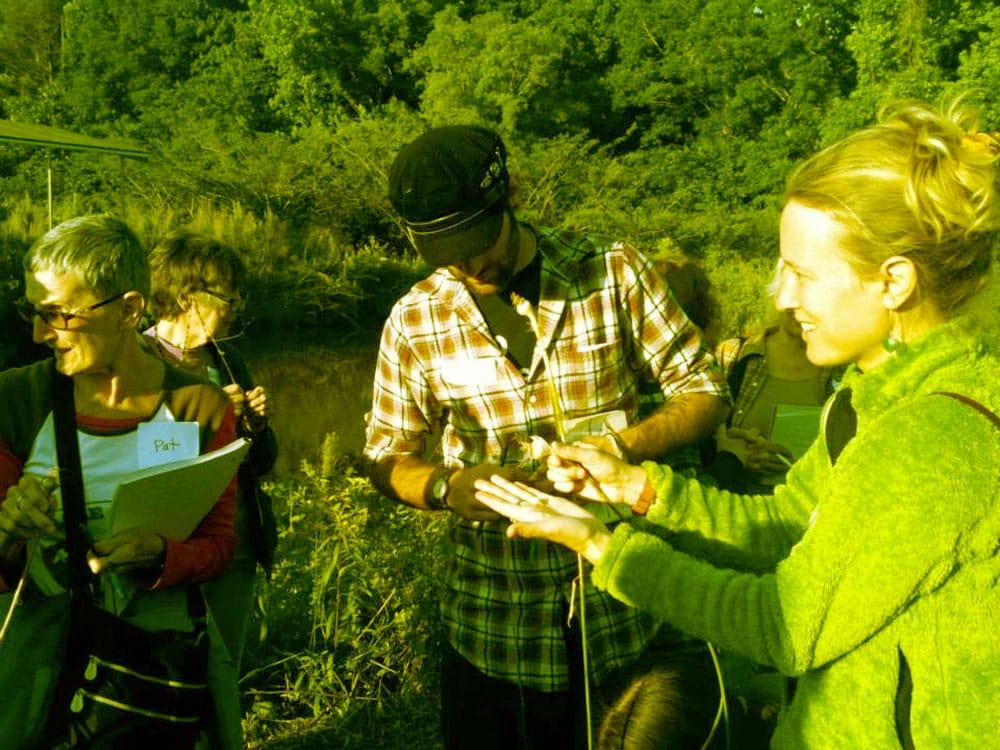 Kim Calhoun teaching workshop participants how to collect wild edibles.