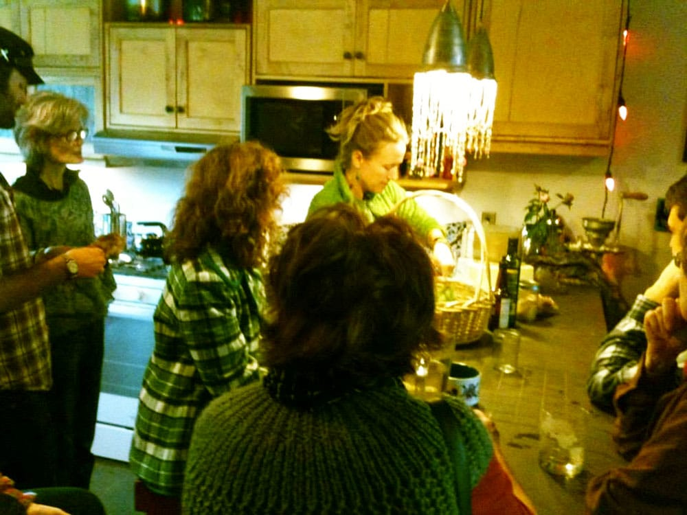 In the kitchen at Abundance NC, whipping up some delicious pesto.