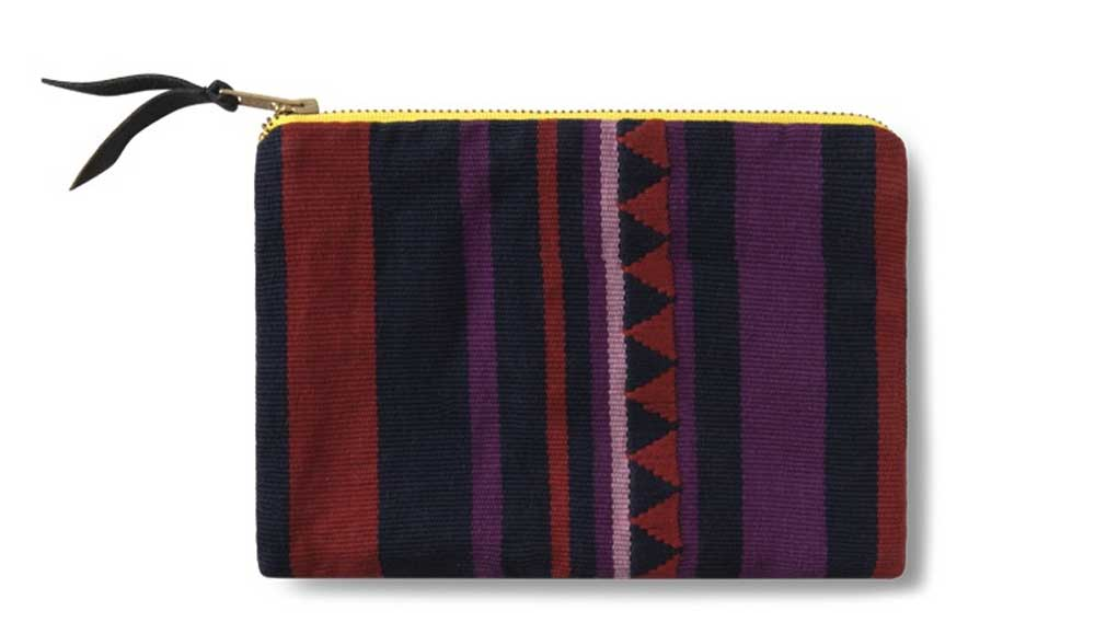 A clutch sewn by Opportunity Threads,, a worker owned cut and sew company in Morganton, NC.