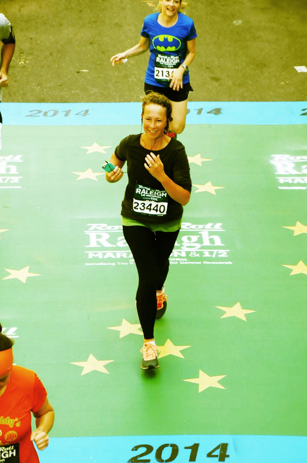 Crossing the finish line of the half marathon last year.